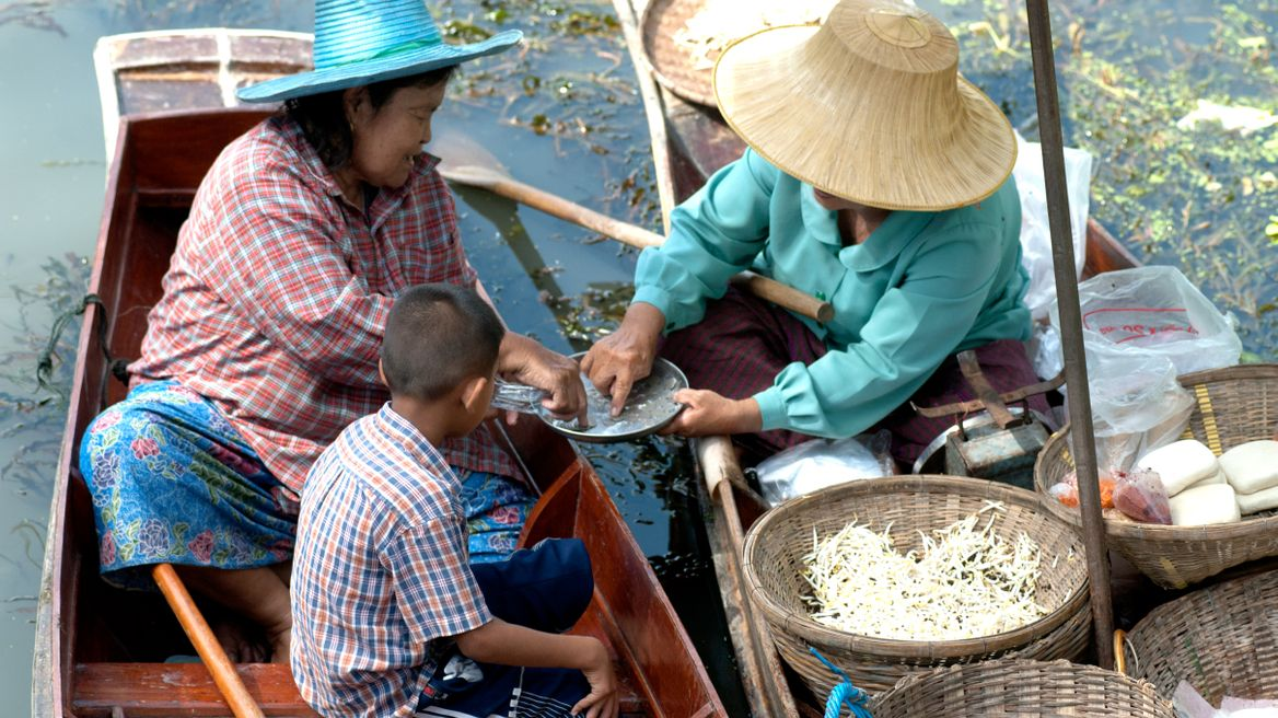 See the locals selling their products on the boat