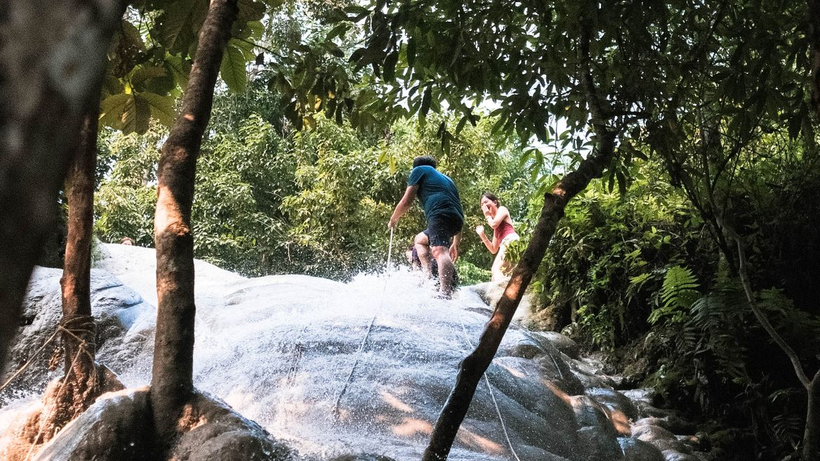 Grab the robes and climb on Bua Tong Waterfalls