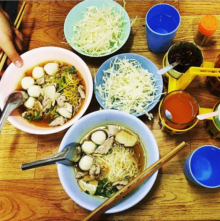 Yummy pork noodles  ; The old pork noodles restaurant in Warorot market. Special recipes are Soup of marinate pork and home made meatball.