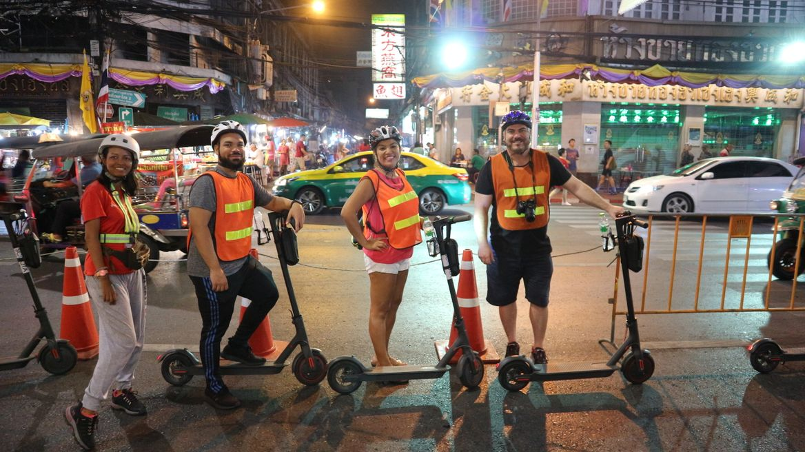 Join a group to scooter around Bangkok at night