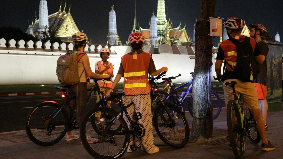 See sights like the Royal Grand Palace lit up at night