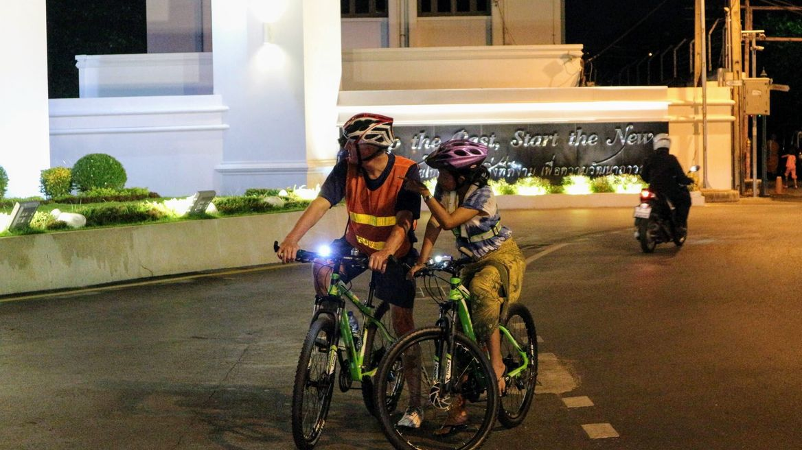 Ride around Bangkok at night with a local guide