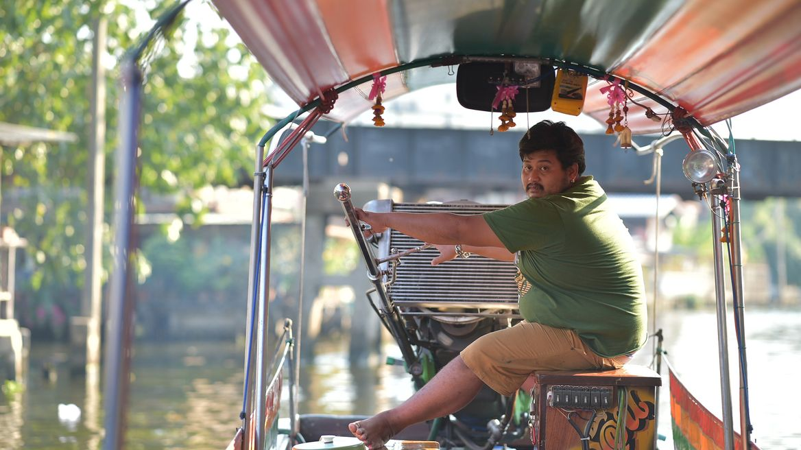 This is one of Thailand's iconic long-tail boats. This boat offers a great canal tour that lets you see Bangkok's ancient waterway transport system up close.