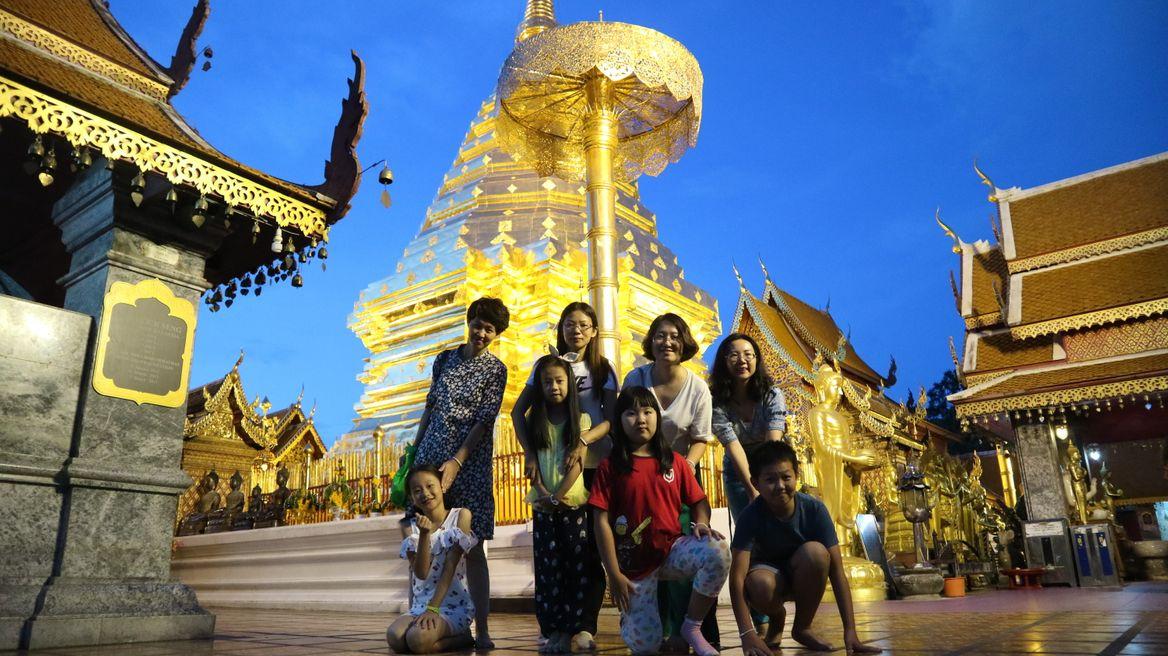 golden Doi sutep temple after sunset