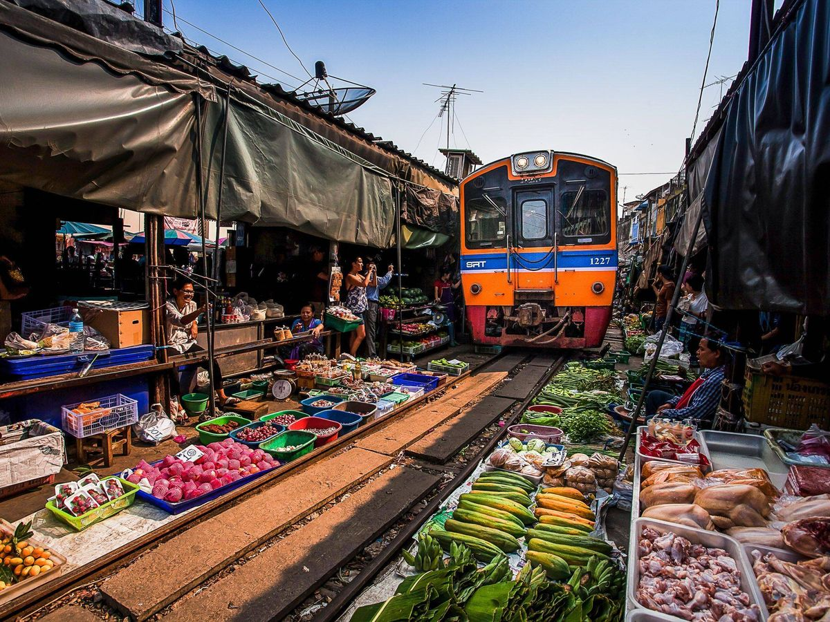 Maeklong Railway Market (umbrella market) - the train is approaching!