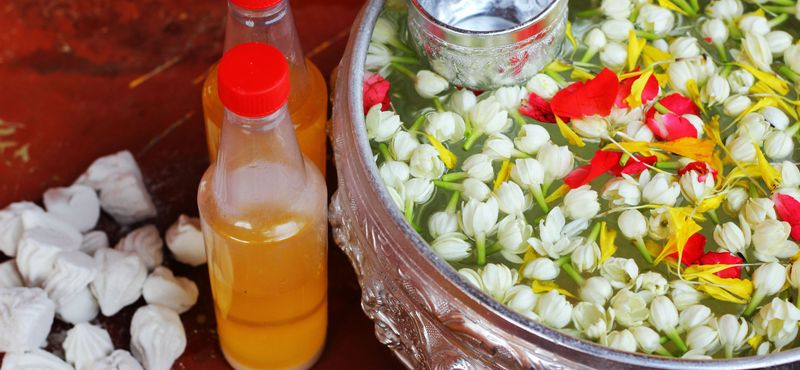 Public Holidays and Festivals in Thailand: Scented water and flowers traditionally used during Songkran Festival
